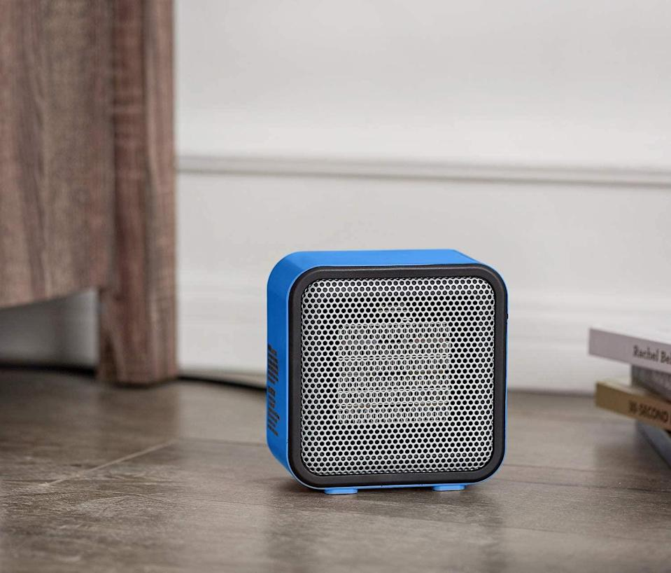 "<h2>Amazon Basics 500-Watt Ceramic Personal Mini Heater</h2><br>Create a warm, comfy environment in any small space dwelling with this AmazonBasics Ceramic Personal Heater. This option uses a naturally-conducive ceramic element, which heats up in seconds. Win-win. <br><br><strong>The Hype:</strong> 4.5 out of 5 stars and 10,746 reviews on <a href=""https://www.amazon.com/dp/B074MXC3PN"" rel=""nofollow noopener"" target=""_blank"" data-ylk=""slk:Amazon"" class=""link rapid-noclick-resp"">Amazon</a> <br><br><strong>Warm People Say: </strong>""I thought 500 watts sounded like nothing when I had cold toes, but it seemed like a lot more when I was looking at electric bills. Our electric bill has done something like quadrupled in the last decade. So I did the math and even if I leave this on 24 hours a day, it is less than a dollar a day. That works for my poor little frozen icicle toes."" — <em>Trouble, Amazon reviewer</em><br><br><strong>Amazon Basics</strong> Amazon Basics 500-Watt Ceramic Small Space Personal Min, $, available at <a href=""https://www.amazon.com/dp/B074MXC3PN"" rel=""nofollow noopener"" target=""_blank"" data-ylk=""slk:Amazon"" class=""link rapid-noclick-resp"">Amazon</a>"