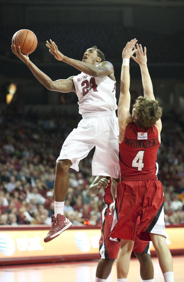 Arkansas' Michael Qualls (24) goes up for the basket as Louisiana's Steven Wronkoski (4) defends in the first half of an NCAA college basketball game in Fayetteville, Ark., Friday, Nov. 15, 2013. (AP Photo/Sarah Bentham)