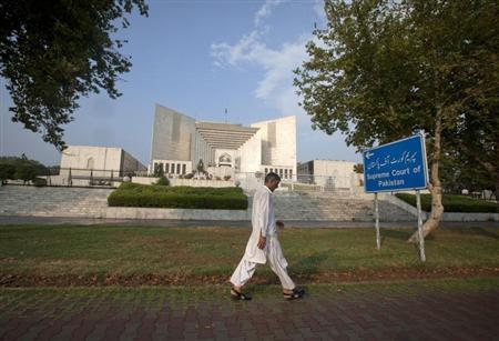 A man walks past the Supreme Court building in Islamabad