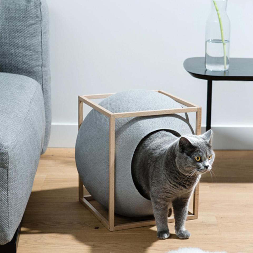 """<p>Looking for a tailor-made cat bed? Successfully launched off of <a href=""""https://www.kickstarter.com/projects/meyou/meyou-classy-furniture-for-discerning-cat"""" rel=""""nofollow noopener"""" target=""""_blank"""" data-ylk=""""slk:Kickstarter"""" class=""""link rapid-noclick-resp"""">Kickstarter</a>, Meyou Paris designed a line of cat beds with a modernist's style in mind. A soft sphere, both a comfortable cocoon and a scratcher, on a stylish stand mixing wood and metal.</p> <p><strong><em>Shop Now: </em></strong><em>Meyou Paris The Cube, $199, </em><a href=""""https://www.luminaire.com/store/accessories/home-utensils/cube-cat-house/"""" rel=""""nofollow noopener"""" target=""""_blank"""" data-ylk=""""slk:luminaire.com"""" class=""""link rapid-noclick-resp""""><em>luminaire.com</em></a><em>.</em></p>"""