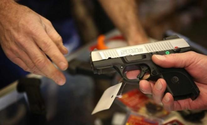 A customer shops for a pistol at a sporting goods store in Illinois on Dec. 17.