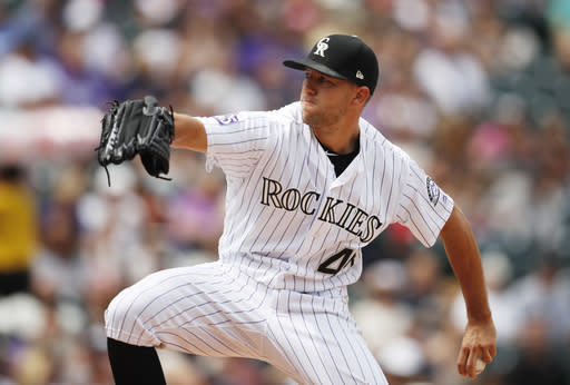 Colorado Rockies starting pitcher Tyler Anderson works against the San Francisco Giants in the first inning of a baseball game Monday, Sept. 3, 2018, in Denver. (AP Photo/David Zalubowski)