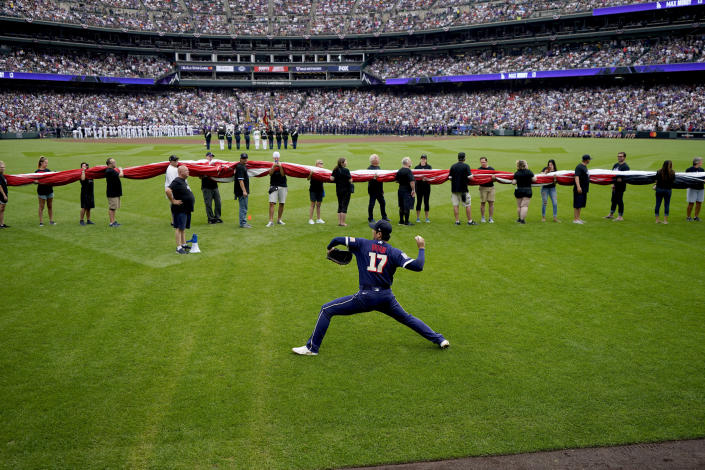 American League's Shohei Ohtani, of the Los Angeles Angeles, warms up prior to the MLB All-Star baseball game, Tuesday, July 13, 2021, in Denver. (AP Photo/Gabriel Christus)
