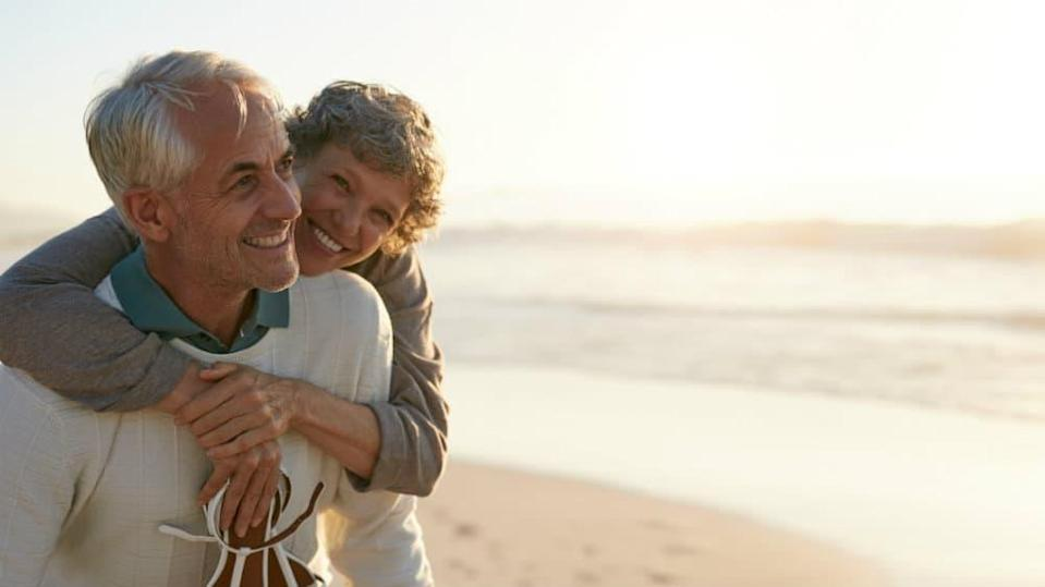 Happy retired couple on a beach