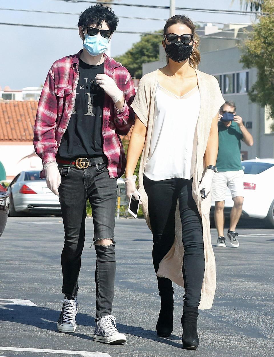 <p>Kate Beckinsale and boyfriend Goody Grace mask up while out and about in L.A. on Wednesday. </p>