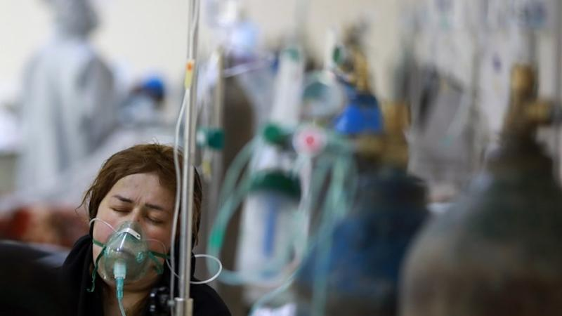 An Afghan woman breaths through an Oxygen mask in Afghan-Japan special hospital for Covid-19 patients in Kabul