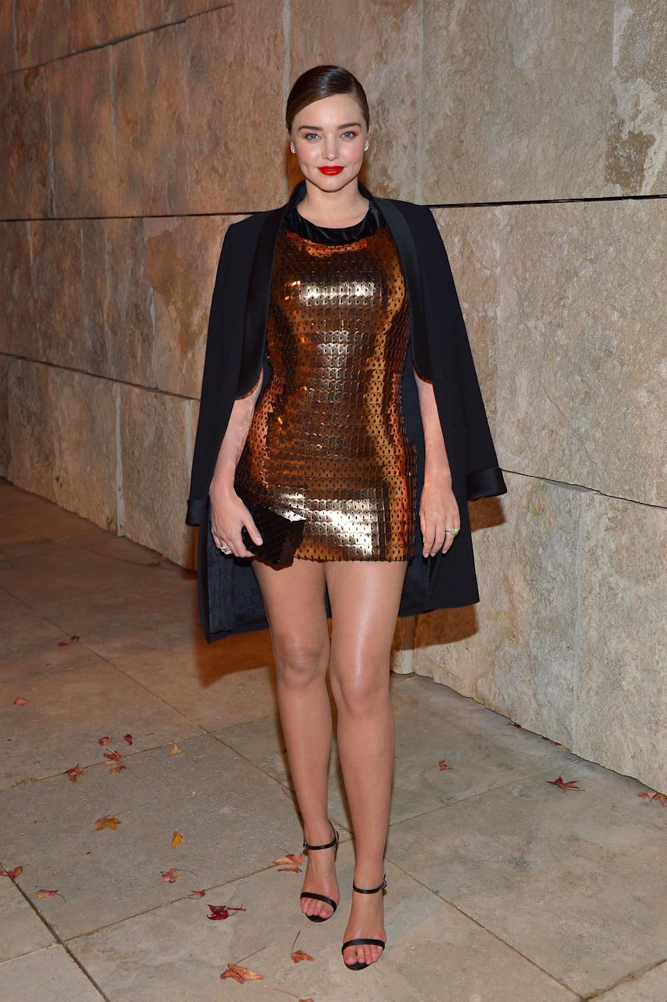 <p>The model mom showed some leg in a mini-dress and blazer by Tom Ford. </p>