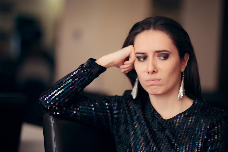 Upset girl feeling depressed attending a social gathering