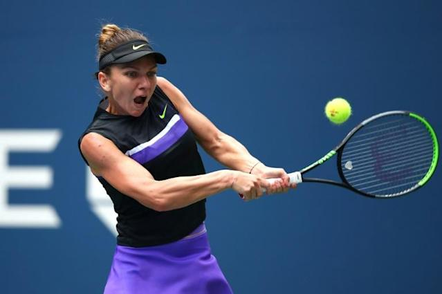 Reigning Wimbledon champion Simona Halep, a first-round US Open loser the past two years, advanced to the second round of the Grand Slam event on Tuesday (AFP Photo/CLIVE BRUNSKILL)