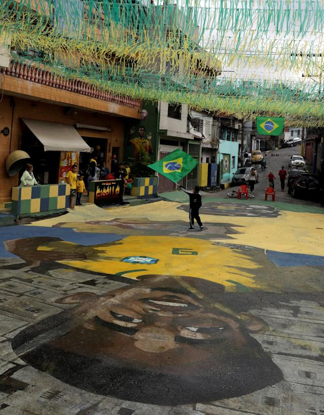 The image of Brazilian soccer player Gabriel Jesus is seen painted on the street in the neighbourhood where he lived in his childhood in Sao Paulo, Brazil, June 17, 2018. REUTERS/Paulo Whitaker