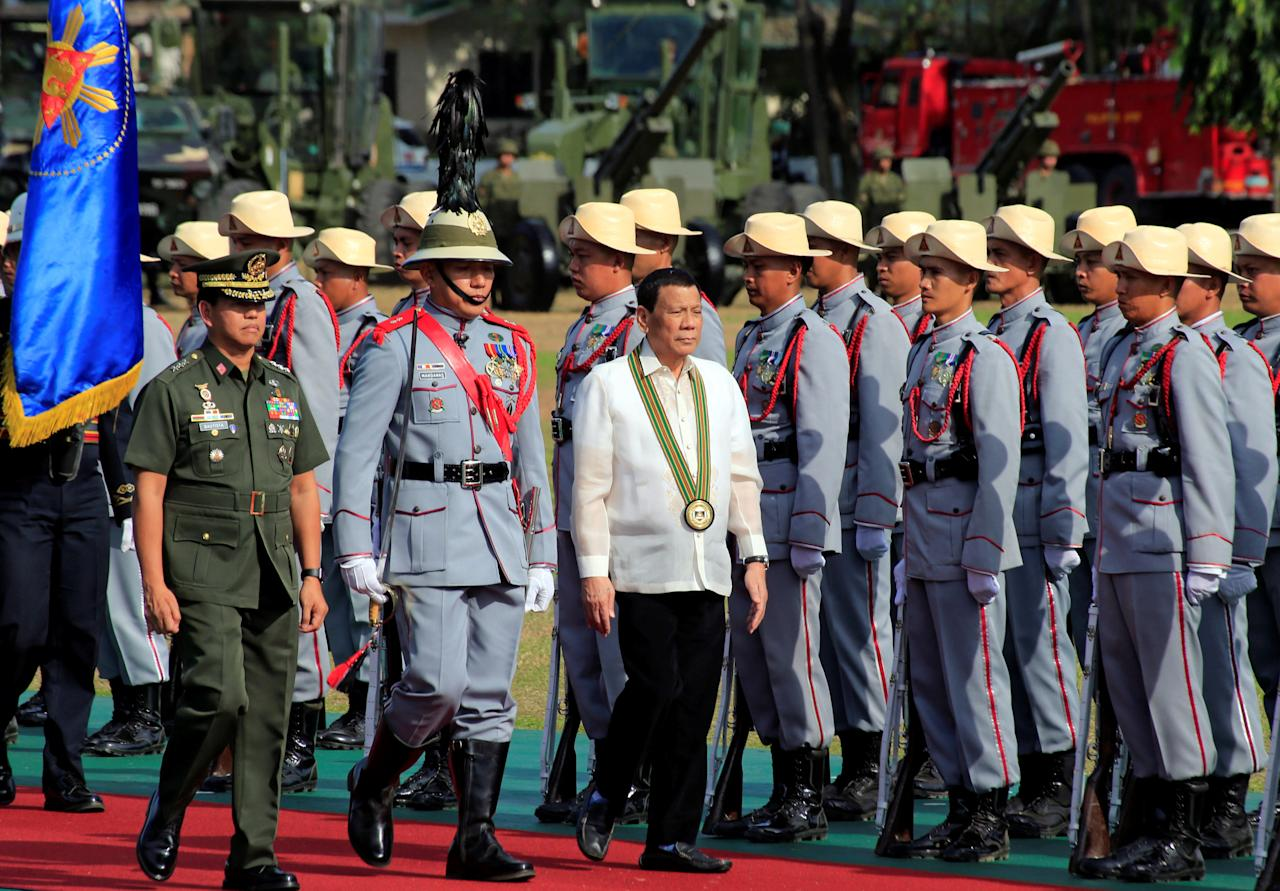 Philippine President Rodrigo Duterte reviews honor guards upon his arrival during the 121st founding anniversary of the Philippine Army (PA) in Taguig city, Metro Manila, Philippines March 20, 2018. REUTERS/Romeo Ranoco