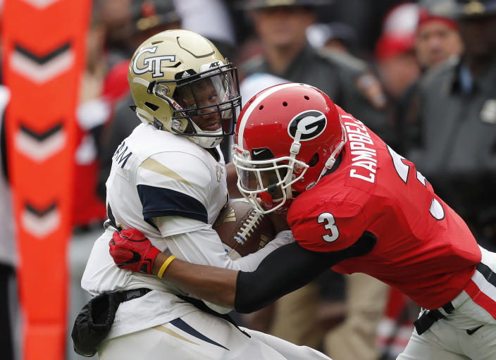 FILE - In this Saturday, Nov. 24, 2018 file photo, Georgia Tech quarterback James Graham (4) is tackled by Georgia defensive back Tyson Campbell (3) after a catch in the second half an NCAA college football game in Athens, Ga. Daniel Jeremiah noted that Georgia teammates Tyson Campbell and Eric Stokes plus Florida State's Asante Samuel Jr. as cornerbacks who could still be available early in the second round. The Packers could use some cornerback help and also would like to boost their depth on both sides of the line of scrimmage. (AP Photo/John Bazemore, File)