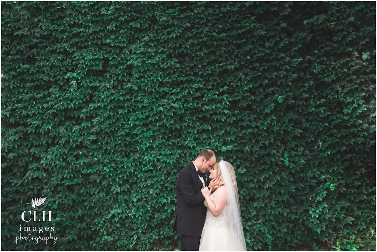 """""""Maria and Andy had a few moments to sneak off for photos alone before joining cocktail hour. As they enjoyed the break from the scattered rain, I asked Andy to close his eyes and remember exactly what he felt the first time he knew he was in love with Maria. When he opened his eyes, he gazed into hers and began to cry."""" --&nbsp;<i>Carrie Lynn Holligan Smith&nbsp;</i>"""