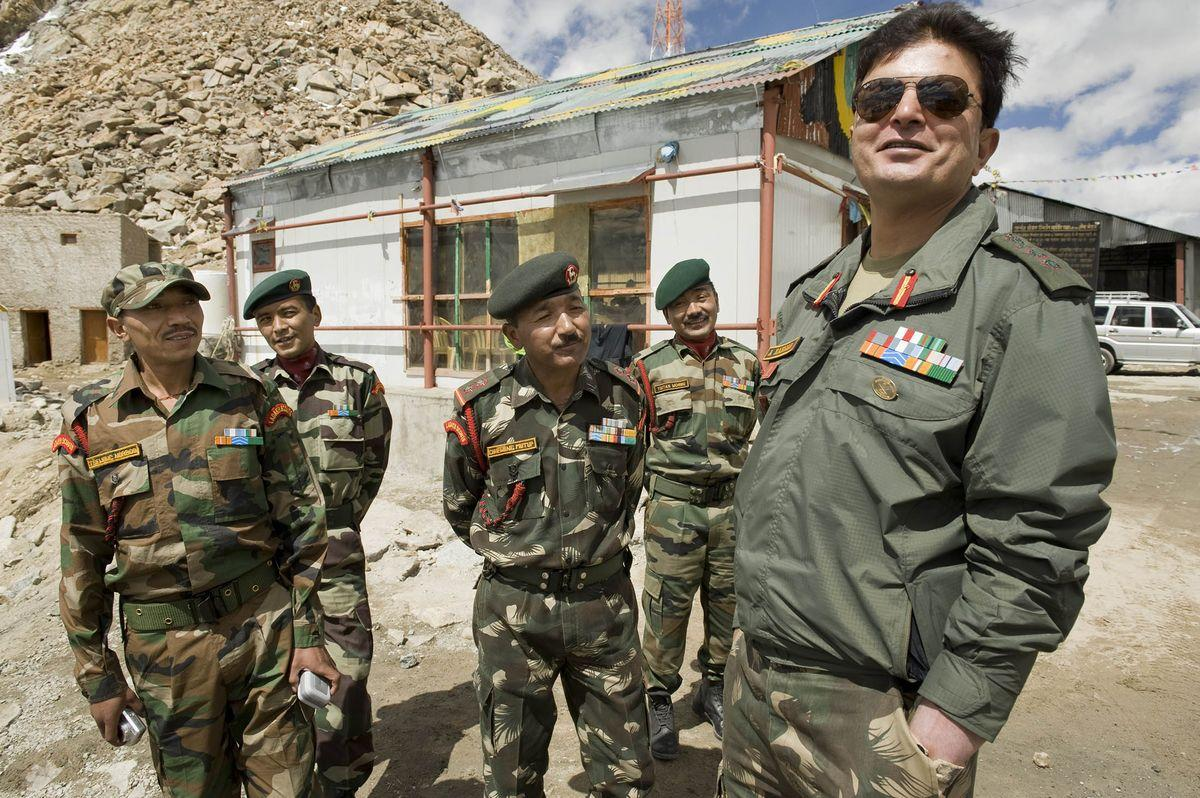 KHARDUNG LA, INDIA - SEPTEMBER 12: A colonel in the Indian army (far right, name withheld), stands with members of the Ladakh scouts (infantry regiment) at Khardung La, a mountain pass in the Ladakh Range of the Himalayas in the Jammu and Kashmir region of India. The pass is strategically important to India, used to carry essential supplies to the Siachen Glacier which lies on the Pakistan border. The border contention between India, China and Pakistan is among the largest land-boundary disputes in the world. (Photo by Mary Knox Merrill/The Christian Science Monitor/Getty Images)