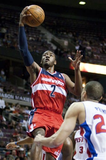 Washington Wizards' John Wall (2) goes to the basket against Detroit Pistons' Tayshaun Prince (22) in the first half of an NBA basketball game, Thursday, April 5, 2012, in Auburn Hills, Mich. (AP Photo/Duane Burleson)