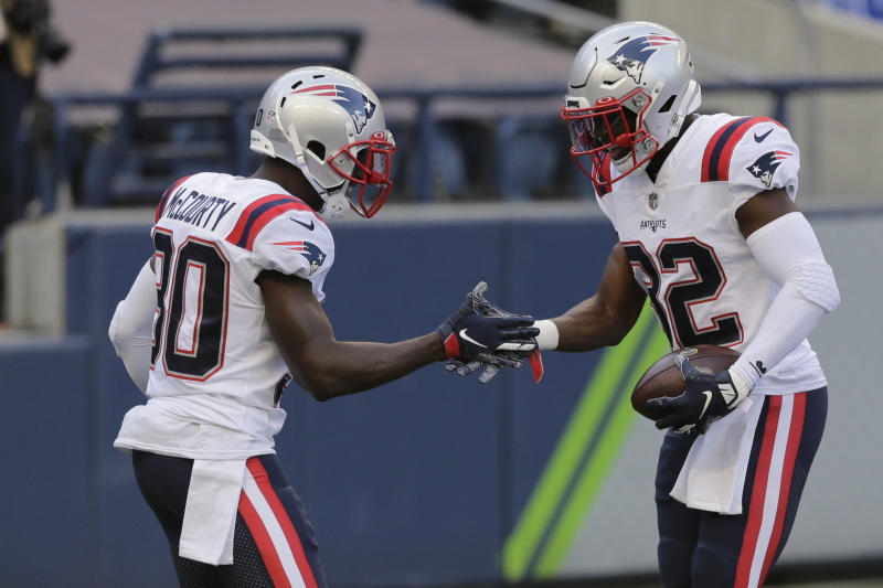 New England Patriots free safety Devin McCourty, right, and his twin brother Jason McCourty will try lead a big upset in Kansas City. (AP Photo/John Froschauer)