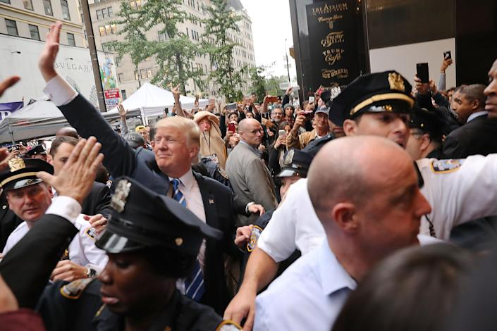 Donald Trump greets supporters outside Trump Tower on Oct. 8, 2016. (Photo: Spencer Platt/Getty Images)