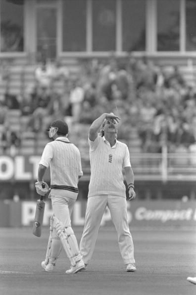 Aug 1985 : Ian Botham makes a gesture to the England dressing room as South African Kepler Wessels comes into bat for his adopted Australia during the 5th Test at Edgbaston.         Mandatory Credit:  Adrian Murrell/Allsport UK