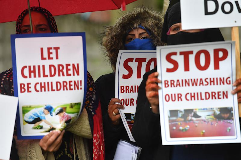 Protestors hold their first demonstration since an injunction was granted barring action immediately outside Anderton Park Primary School, in Moseley, Birmingham, over LGBT relationship education materials being used at the school. (Photo by Jacob King/PA Images via Getty Images)