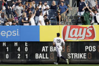 New York Yankees right fielder Aaron Judge (99) watches as fans catch a solo home run hit by Texas Rangers' Jose Trevino during the fifth inning of a baseball game Monday, Sept. 2, 2019, in New York. (AP Photo/Adam Hunger)
