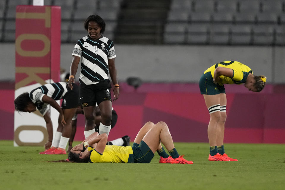 Australia's Charlotte Caslick, center, and Maddison Levi react after their team lost to Fiji in their women's rugby sevens quarterfinal match at the 2020 Summer Olympics, Friday, July 30, 2021 in Tokyo, Japan. (AP Photo/Shuji Kajiyama)