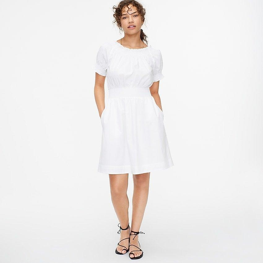 """<br><br><strong>J.Crew</strong> Smocked puff-sleeve cotton poplin dress, $, available at <a href=""""https://go.skimresources.com/?id=30283X879131&url=https%3A%2F%2Fwww.jcrew.com%2Fp%2Fwomens%2Fcategories%2Fclothing%2Fdresses-and-jumpsuits%2Fsmocked-puff-sleeve-cotton-poplin-dress%2FAY883%3Fdisplay%3Dsale%26fit%3DClassic%26isFromSale%3Dtrue%26color_name%3Dwhite%26colorProductCode%3DAY883"""" rel=""""nofollow noopener"""" target=""""_blank"""" data-ylk=""""slk:J. Crew"""" class=""""link rapid-noclick-resp"""">J. Crew</a>"""