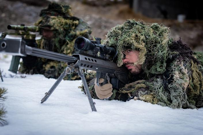 A sniper and his spotter of the Spanish Lepanto Battalion line up their target. The snipers of the Battalion train their marksmanship near Folldal during Exercise Trident Juncture. They make use of the .50 caliber Barrett and the .338 caliber Accuracy sniper rifles, firing at targets over 1.000 meters away.