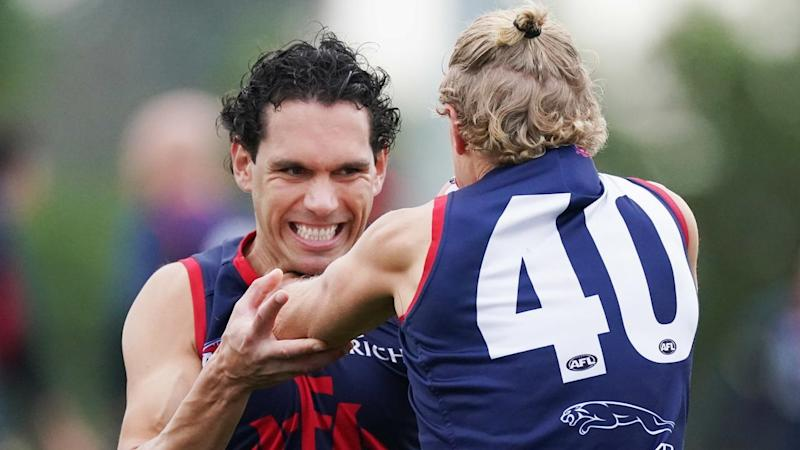 Demon Harley Bennell (l) will play his first AFL game in 34 months this weekend against Carlton