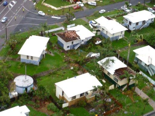 """A """"mini-tornado"""" ripped the roofs off houses in Townsville, March 20, 2012, leaving thousands without power. The Queensland State Emergency Service said it had received dozens of calls for help, with authorities trying to determine whether anyone had been injured"""