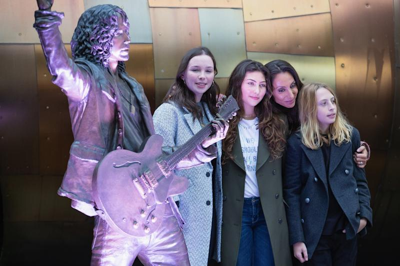 Lily Cornell, Toni Cornell, Vicky Cornell and Christopher Cornell unveil a life-size statue of singer Chris Cornell during the public unveiling ceremony at MoPop on October 7, 2018 in Seattle, Washington. (Photo: Mat Hayward/Getty Images)