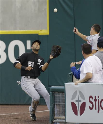 Chicago White Sox right fielder Alex Rios catches the fly in foul territory hit by Detroit Tigers' Torii Hunter during the third inning of a baseball game in Detroit, Tuesday, July 9, 2013. (AP Photo/Carlos Osorio)