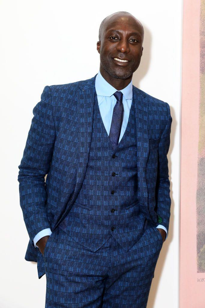 "<p>As a child, British-born Ozwald Boateng was inspired by his father's immaculate suits. At eight, his mother gave him his first suit—a double-breasted in purple mohair. At 14, he found a summer job sewing linings into suits. It was his girlfriend who ultimately got him into designing when he was 16. In 1987, Boateng helped his friend make clothes for a fashion show, and his work received high praise. He sold his first collection to a menswear shop in Covent Garden, which allowed him to open his own studio in London in 1991. In 1994, Boateng was the first tailor to have a show during Paris Fashion week. He then opened a boutique on the famed Saville Row in 1995. <a href=""https://peoplepill.com/people/ozwald-boateng/"" rel=""nofollow noopener"" target=""_blank"" data-ylk=""slk:Boateng's contemporary approach to menswear design"" class=""link rapid-noclick-resp"">Boateng's contemporary approach to menswear design</a> helped to forge a new appreciation for Savile Row and draw in a younger demographic. To this day it remains the only Black-owned store on Saville Row. In 2004, Boateng was named Creative Director of Menswear at Givenchy, specifically hired to ""reinvent the French gentleman."" Boateng was commissioned by President of the Republic of Ghana to design and orchestrate a show at the 9th Annual African Union summit in 2007. In 2018, Boateng designed new uniforms for British Airways.<br> </p>"