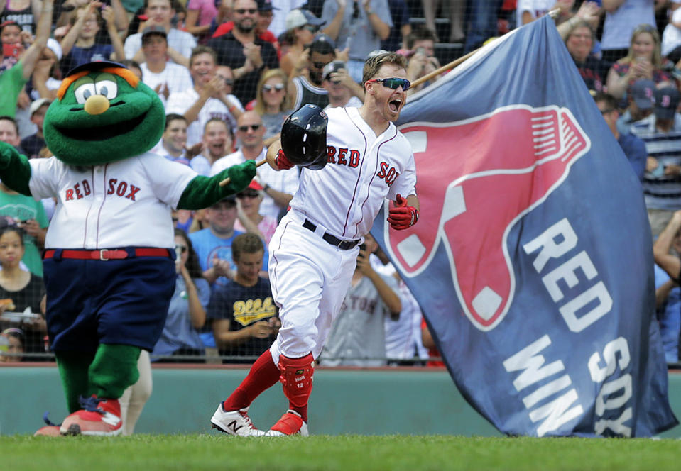 BOSTON - AUGUST 22: After he knocked in the game winning run with a bottom of the tenth inning RBI single, Boston Red Sox second baseman Brock Holt celebrates with team mascot Wally the Green Monster at left. The Boston Red Sox host the Kansas City Royals in the conclusion of a regular season MLB baseball game that was suspended by weather in the top of the tenth inning earlier in the month at Fenway Park in Boston on Aug. 22, 2019. (Photo by Jim Davis/The Boston Globe via Getty Images)