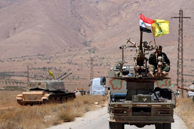 Hezbollah and Syrian flags flutter on a military vehicle in Qalamoun, Syria, in 2017. (Photo: Omar Sanadiki/Reuters)