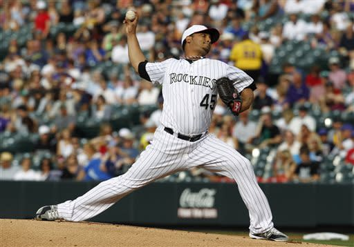 Colorado Rockies starting pitcher Jhoulys Chacin works against the Los Angeles Dodgers in the first inning of a baseball game in Denver on Thursday, July 4, 2013. (AP Photo/David Zalubowski)