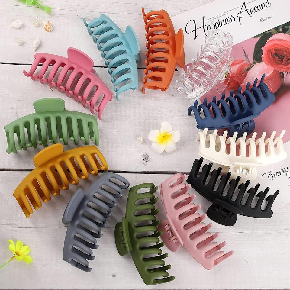 <p>Keep your hair out of your face with these stylish 90's-inspired colorful <span>12 Pack Hair Claw Clips</span> ($10).</p>