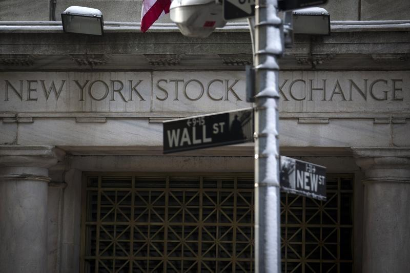 The Wall St. sign is seen outside the door to the New York Stock Exchange in New York's financial district