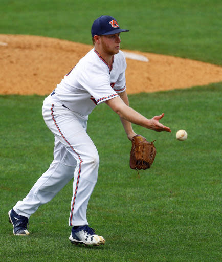 Auburn pitcher Davis Daniel (13) throws to first for the out during the fifth inning of a Southeastern Conference NCAA college baseball game against Kentucky, Tuesday, May 22, 2018, in Hoover, Ala. (AP Photo/Butch Dill)