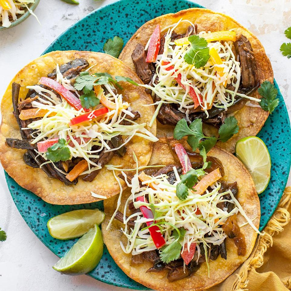 <p>Serve the tangy, peppery beef on crispy tostadas and top with colorful slaw.</p>
