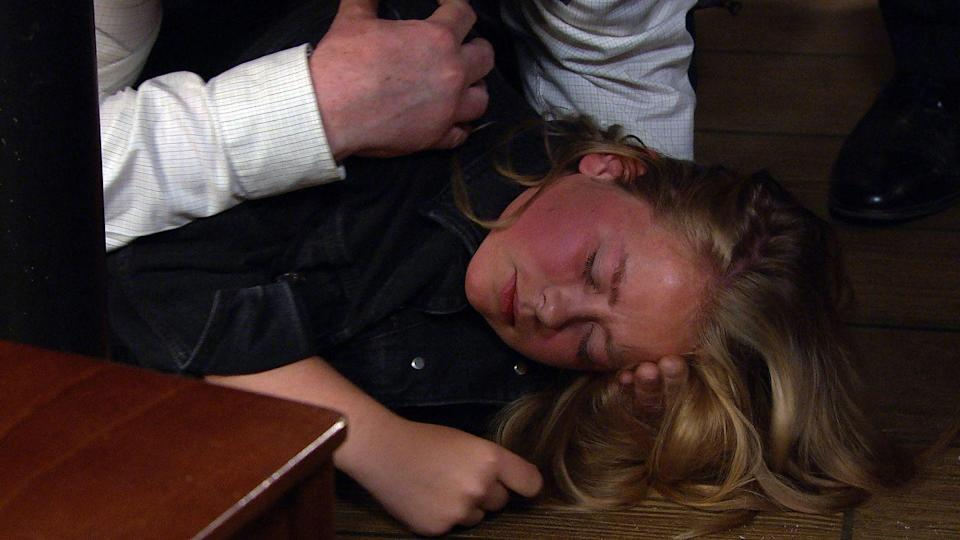 <p>She falls to the ground at the cafe.</p>