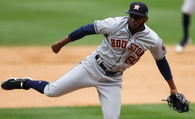 Astros win 8th straight, pounding Rox with 2 5-run frames