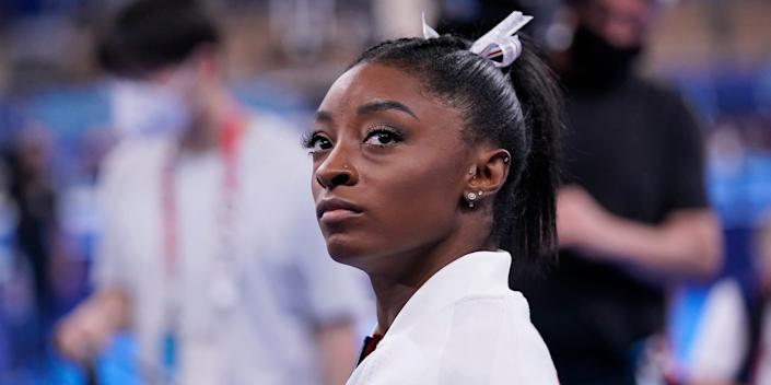 Simone Biles, of the United States, waits for her turn to perform during the artistic gymnastics women's final at the 2020 Summer Olympics, Tuesday, July 27, 2021, in Tokyo.