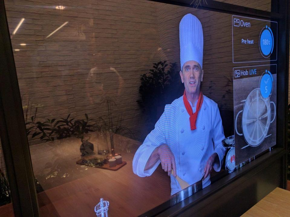 A chef appears on a large OLED.