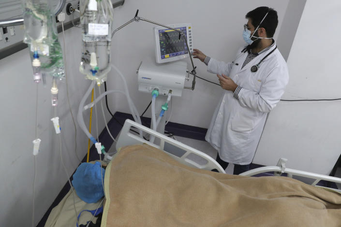 A medical staffer checks the data of a COVID-19 patient on a screen at the intensive care unit of the Rafik Hariri University Hospital in Beirut, Lebanon, Friday, Jan. 22, 2021. Hospitals in Lebanon are reaching full capacity amid a dramatic surge in coronavirus cases across the crisis-hit Mediterranean nation even amid strict lockdown. (AP Photo/Bilal Hussein)