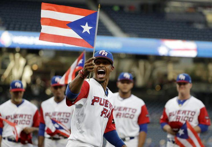 Francisco Lindor (front and center) represented Puerto Rico during the 2017 World Baseball Classic. Now he'll lead the Cleveland Indians to his home country in 2018. (AP)