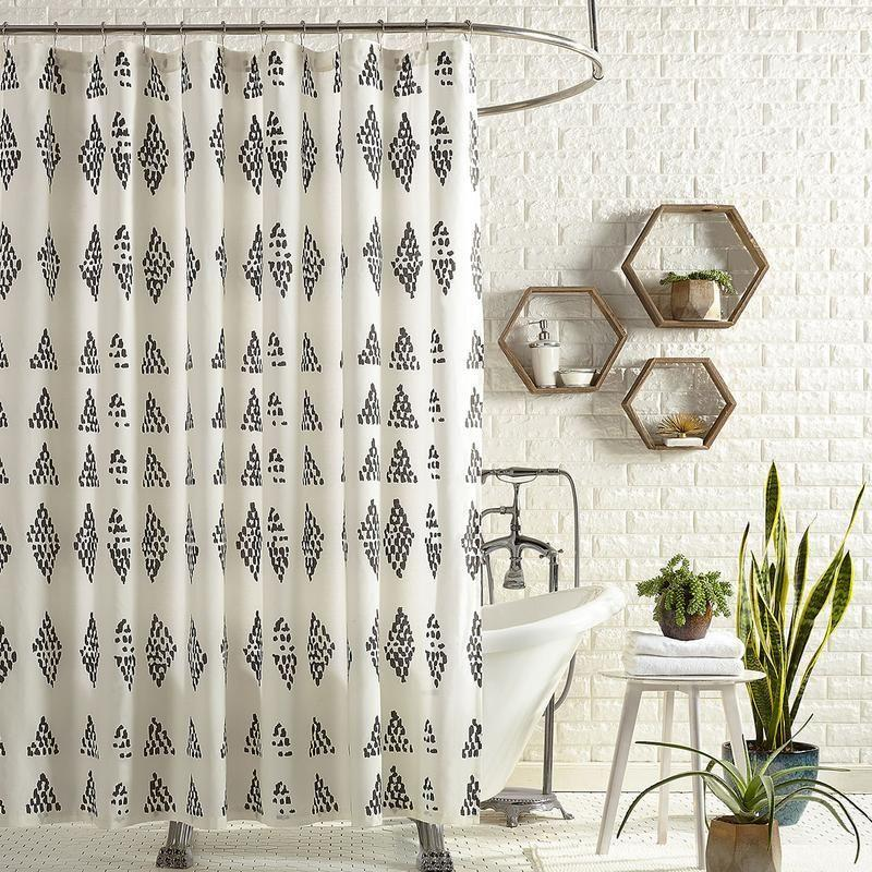 """<p><strong>Jungalow</strong></p><p>jungalow.com</p><p><strong>$62.00</strong></p><p><a href=""""https://www.jungalow.com/collections/bed-bath/products/prosperity-shower-curtain"""" rel=""""nofollow noopener"""" target=""""_blank"""" data-ylk=""""slk:Shop Now"""" class=""""link rapid-noclick-resp"""">Shop Now</a></p><p>Prints don't have to be intimidating. The polka dots on the curtain here are gathered together into little diamond-shaped clusters which will look good in any bathroom.</p>"""