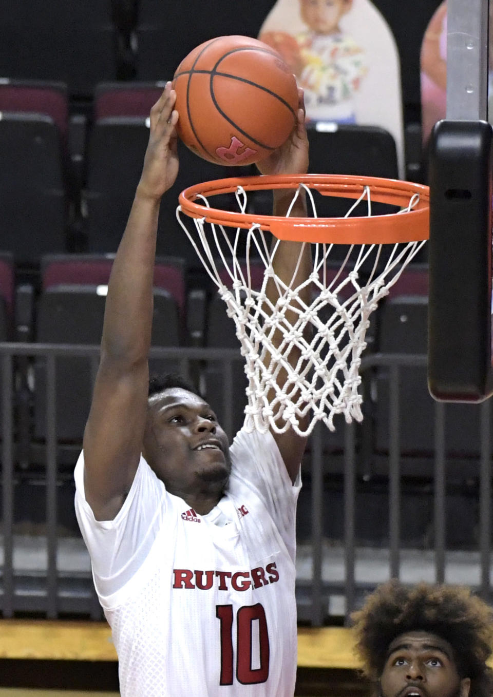 Rutgers guard Montez Mathis dunks during the second half of an NCAA college basketball game against Illinois, Sunday, Dec. 20, 2020, in Piscataway, N.J. (AP Photo/Bill Kostroun)