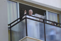 FILE - In this July 11, 2021 file photo, Pope Francis appears on a balcony of the Agostino Gemelli Polyclinic in Rome, where he is recovering from intestinal surgery, for the traditional Sunday blessing and Angelus prayer. Francis is opening his first foreign trip on Sunday, Sept. 12, 2021 since undergoing major intestinal surgery in July, embarking on an intense, four-day, two-nation trip to Hungary and Slovakia that he has admitted might be overdoing it (AP Photo/Gregorio Borgia, file)