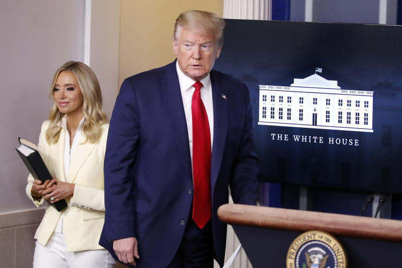 President Donald Trump arrives to speak with reporters about the coronavirus in the James Brady Briefing Room of the White House, Friday, May 22, 2020, in Washington with White House press secretary Kayleigh McEnany. (AP Photo/Alex Brandon)