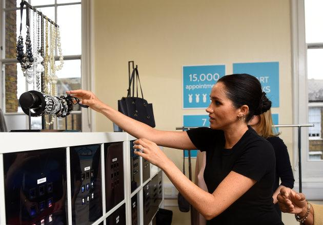 The duchess picks out a bracelet during her visit to Smart Works.